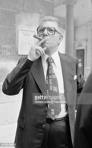 French Senator JeanPierre Fourcade smokes a cigar in Versailles