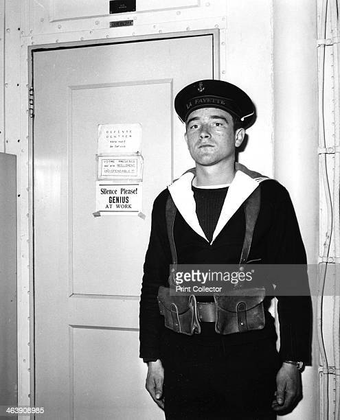 A French sentry outside the operations room of the aircraft carrier 'La Fayette' 1951 The ship formerly the USS 'Langley' was transferred to France...