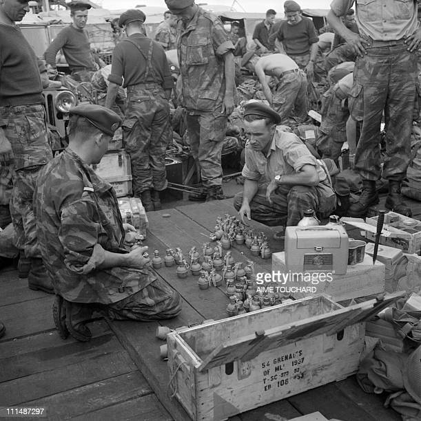 French sergeant distributes grenades to soldiers, October 1956 upon their arrival in Egypt after President Nasser nationalized Suez Canal. End of...