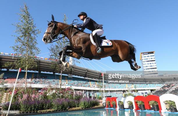 French show jumper Mathieu Billot on his horse Shiva d'Amaury going over a water jump at the Longines FEI European Championships 2017 in Gothenburg,...