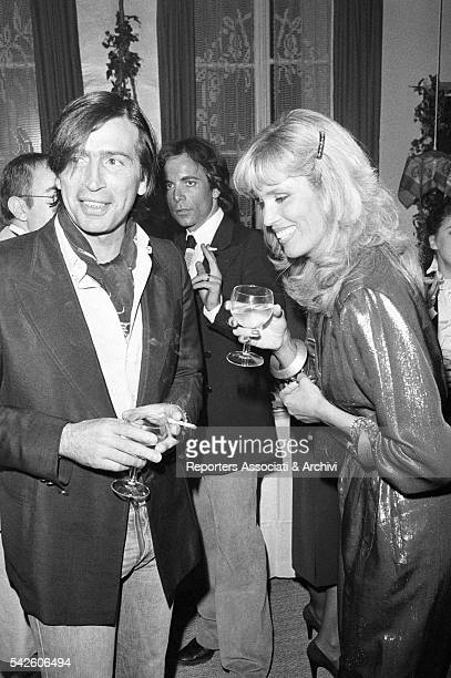 French showgirl Amanda Lear and her husband AlainPhilippe Malagnac at a cocktail Paris 1979