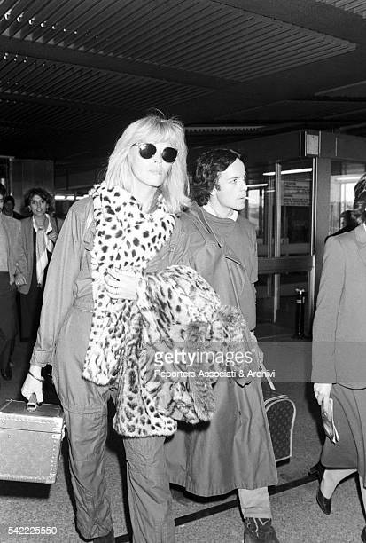 French showgirl Amanda Lear and her husband AlainPhilippe Malagnac in Fiumicino airport Rome 1985