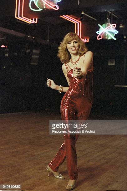French showgirl Amanda Lear dancing in a club in Follie di notte Rome 1978