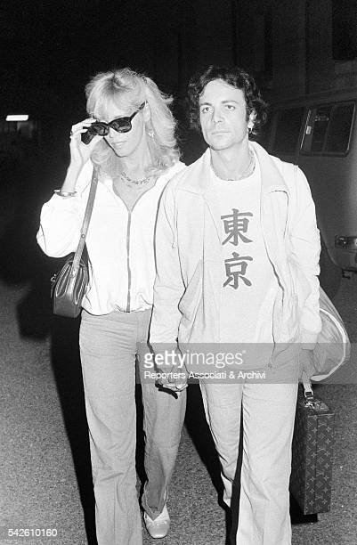 French showgirl Amanda Lear holding hands with her husband AlainPhilippe Malagnac coming out of the TV studios 1979