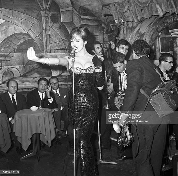 French showgirl Amanda Lear singing in a club in via Veneto Among the audience is Italian playboy Gianfranco Piacentini Rome 1959