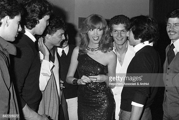 French showgirl Amanda Lear surrounded by fans after one of her shows 1978