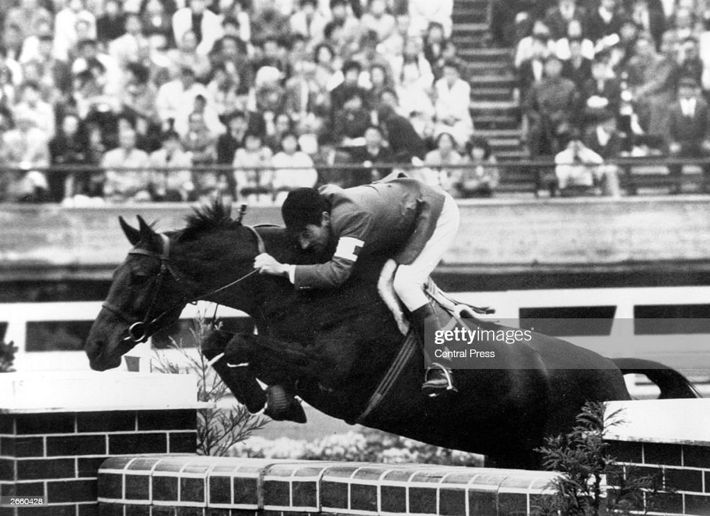 French showjumper Pierre Jonqueres d'Oriola competing in the showjumping event at the Olympic Games, Tokyo. He went on to win the gold medal.