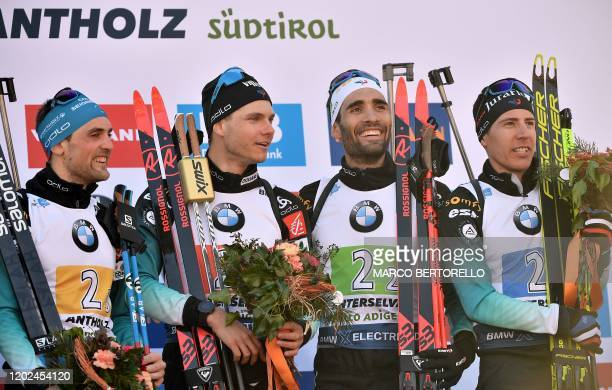French Simon Desthieux, French Emilien Jacquelin, French Martin Fourcade and French Quentin Fillon Maillet celebrate on the podium after winning the...