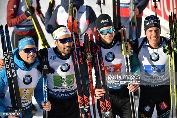French Simon Desthieux French Martin Fourcade French Emilien Jacquelin and French Quentin Fillon Maillet pose after France won the Men 4x75 km Relay...