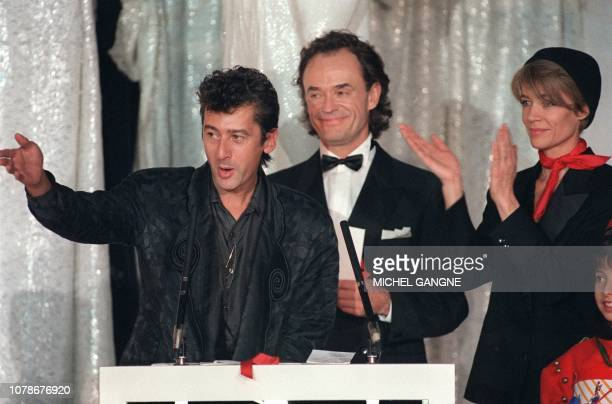 French singer Alain Bashung delivers a speech after receiving from Francoise Hardy and JeanClaude Casadesus the best Rock Album Award during the 2nd...