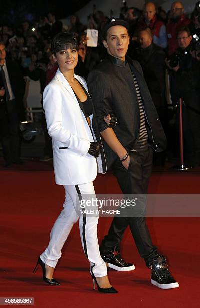 French singer Alizee and French dancer Gregoire Lyonnet arrive at the Palais des Festivals to attend the 15th Annual NRJ Music Awards on December 14...