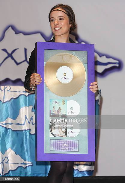 French singer Alizee receives a gold disc for more than 50000 sales of her album Psichédélices at Plaza Inbursa on June 26 2008 in Mexico Mexico City