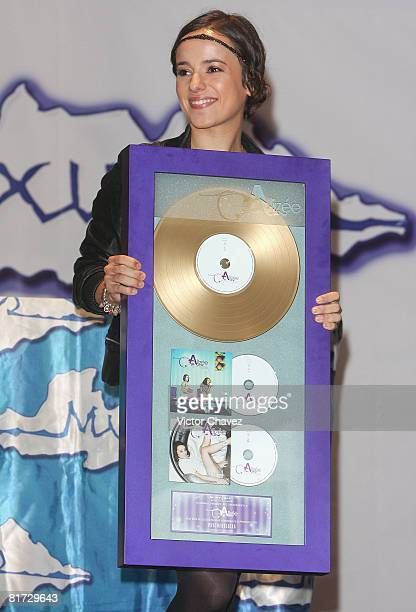 French singer Alizee receives a gold disc for more than 50000 sales of her album Psichedelices at Plaza Inbursa on June 26 2008 in Mexico Mexico City