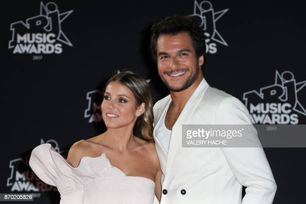 French singer Amir Haddad and his wife Lital pose upon their arrival to attend the 19th NRJ Music Awards at the Palais des Festivals in Cannes...