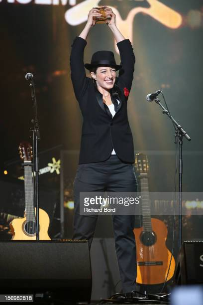 French singer Anais poses onstage as she receives the 'Prix Francis Lemarque' during the 'Grand Prix SACEM 2012' at Casino de Paris on November 26...