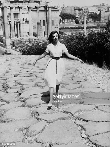 French singer and acress Marie Laforêt sightseeing in the ancient forum in Rome Italy circa 1961