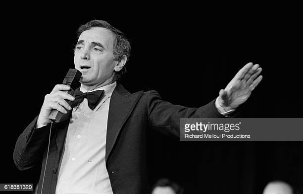 French singer and actor Charles Aznavour performs at the Moulin Rouge on the occasion of the famous dance hall's 90th anniversary Celebrities Jerry...