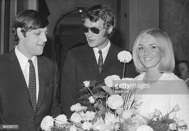 French singer and actor Johnny Hallyday acts as a witness at the wedding of Eddie Vartan and American air hostess Doris Sumner in Paris 20th July 1966