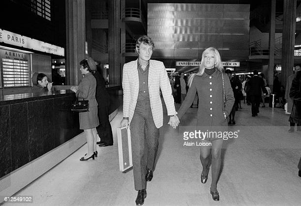 French singer and actor Johnny Hallyday and his wife Bulgarianborn French actress Sylvie Vartan at the Orly airport