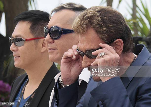French singer and actor Johnny Hallyday Anthony Wong and SiuFai Cheung of Hong Kong pose during the photocall of their movie Vengeance directed by...
