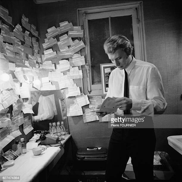 French singer and actor Johnny Hallyday in his dressing room at the Olympia music hall
