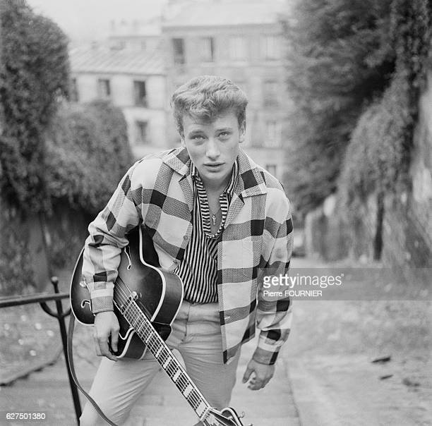 French singer and actor Johnny Hallyday in the streets of Montmartre in Paris April 1960