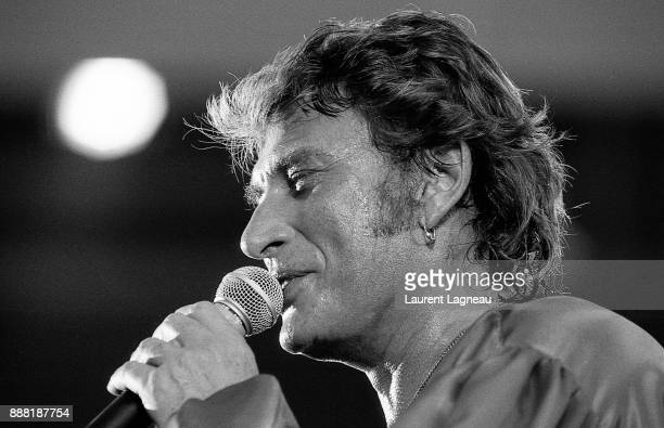 French singer and actor Johnny Hallyday on stage at Parc des Princes stadium.