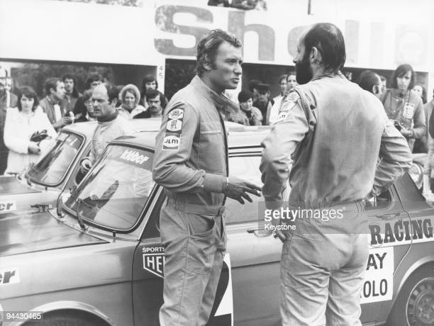 French singer and actor Johnny Hallyday takes part in a celebrity motor race at MagnyCours France 27th October 1975 His codriver is professional...