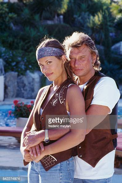 french singer and actor johnny hallyday with his girlfriend karine nachrichtenfoto getty images. Black Bedroom Furniture Sets. Home Design Ideas