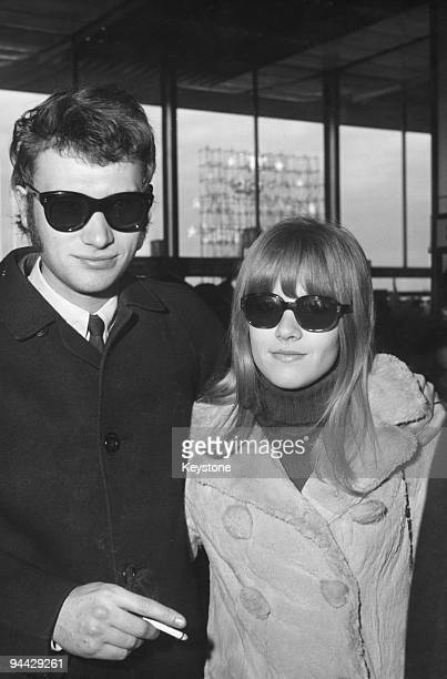 French singer and actor Johnny Hallyday with his wife Sylvie Vartan at Orly Airport in Paris 3rd January 1967 They are en route to Tehran on the...