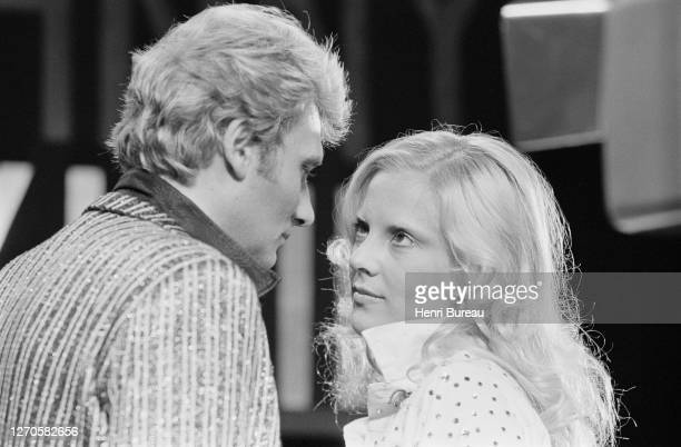 French singer and actor Johnny Hallyday with wife Bulgarian-born French singer Sylvie Vartan on the set of a televised show.
