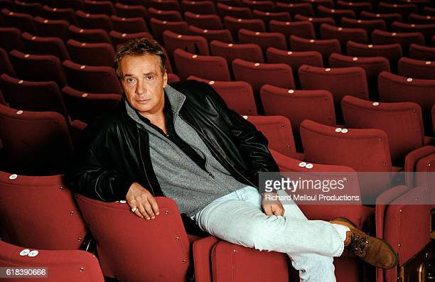 French singer and actor Michel Sardou in the seats at The Theatre of Paris.