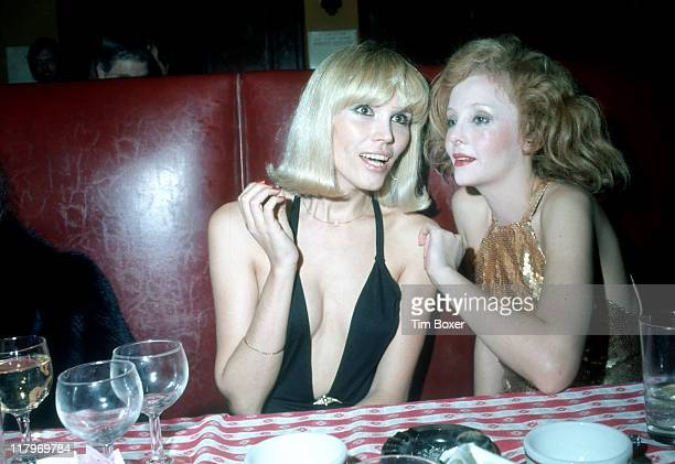 French singer and actress Amanda Lear and South African actress and singer Genevieve Waite sit together at the premiere party for the Broadway show...