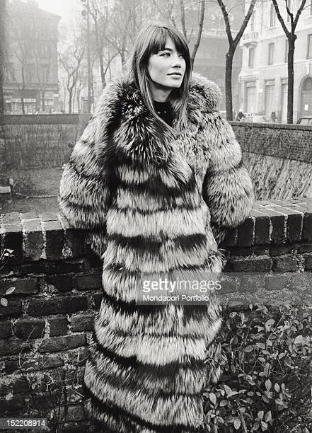 French singer and actress Francoise Hardy posing wearing a fur in piazza Sant'Ambrogio. Milan, 1960s