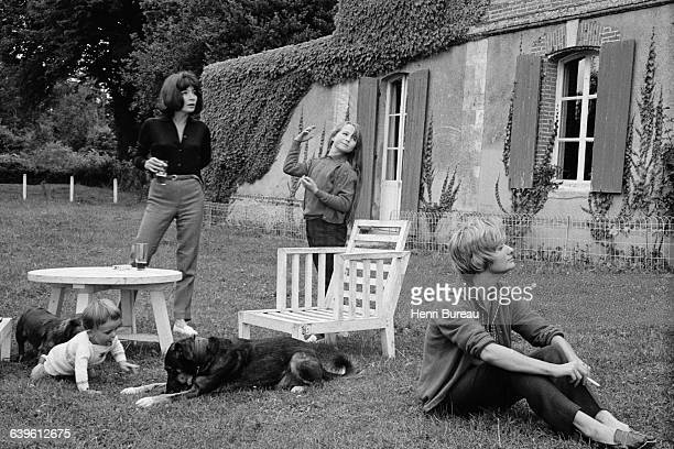 French singer and actress Juliette Greco and her daughter Laurence Lemaire with French novelist Francoise Sagan and a child in a country house