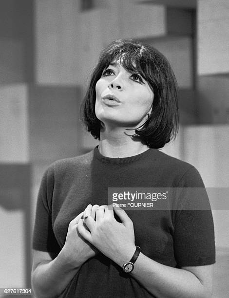 French singer and actress Juliette Greco performs in television show Sacha Show