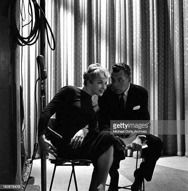 French singer and actress Line Renaud chats with Ed Sullivan backstage on The Ed Sullivan Show on October 12 1958 in New York City New York