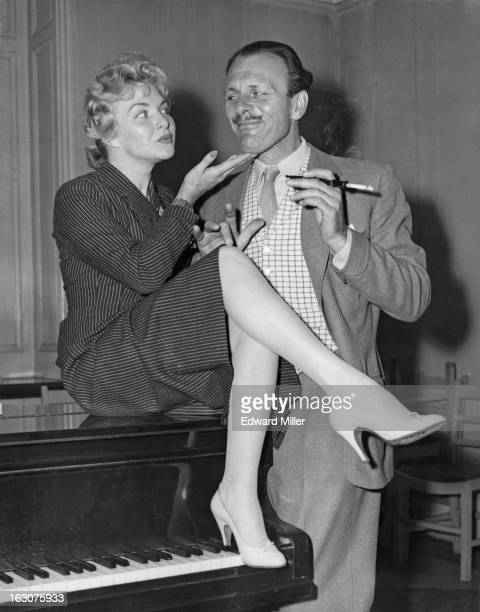 French singer and actress Line Renaud with English comic actor TerryThomas at rehearsals for the BBC TV show 'Around The Town' London 30th September...