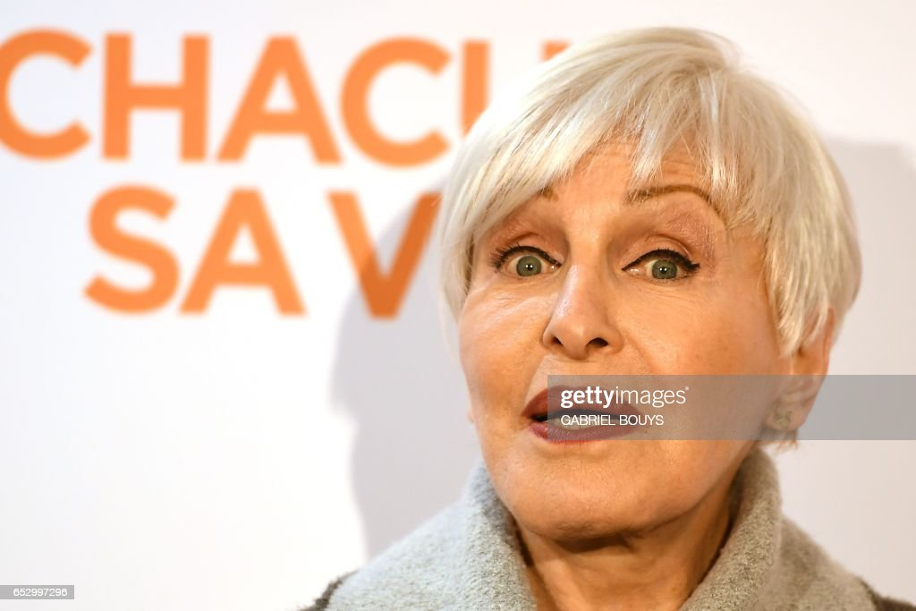 French singer and actress Nicole Croisille poses during the photocall for the premiere of the film 'Chacun Sa Vie' in Paris on March 13, 2017. The film is directed by French director Claude Lelouch