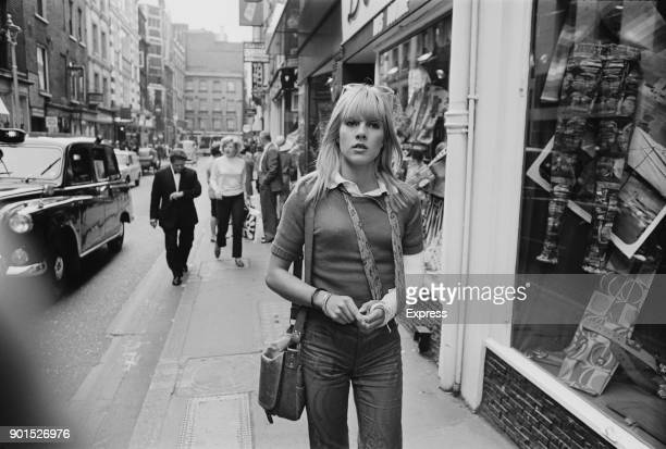 French singer and actress Sylvie Vartan walking in Carnaby Street with a arm in plaster following a car accident London UK 10th June 1968