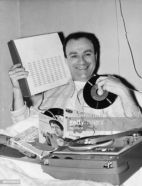 French singer and comedian Fernand Raynaud pictured in bed with his record player following an appendix operation Versailles Hospital circa 1955