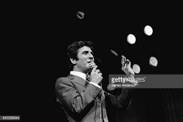 French singer and composer Gilbert Bécaud in concert before an enthusiastic crowd