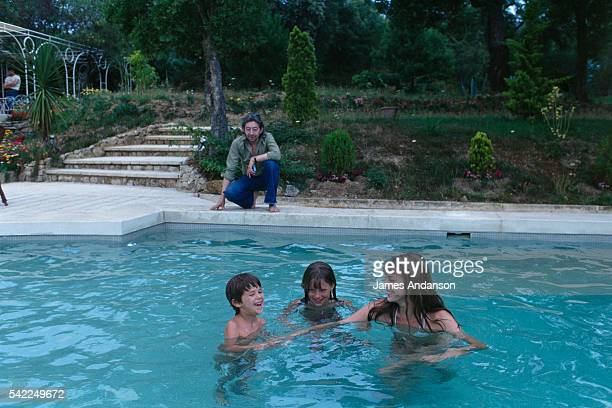 French singer and composer Serge Gainsbourg watching his family British singer and actress Jane Birkin her daughter Kate Barry and the couple's...