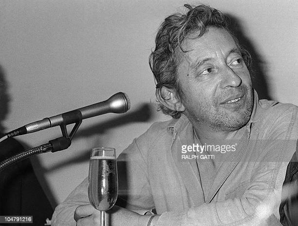 French singer and film director Serge Gainsbourg is pictured on May 8 1983 at a press conference about his movie 'Equateur' presented in official...