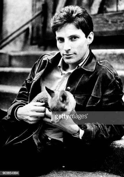 French singer and musician Hugues Aufray poses with a fox on November 29 1964 PHOTO /