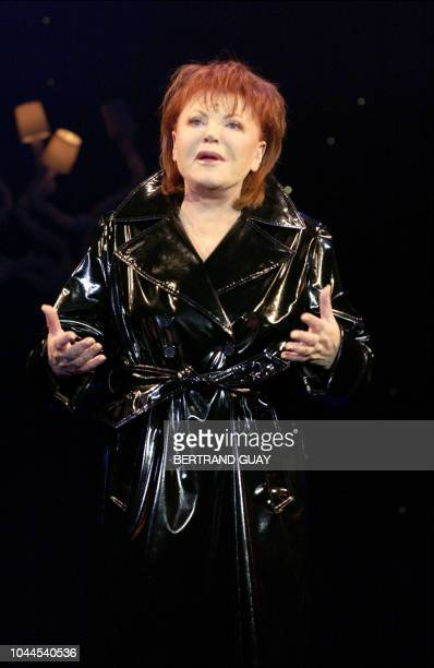 French singer and night clubs owner Regine performs 11 May 2004 at the stage of Paris' Follies Bergeres during her onewomanshow written by Pierre...