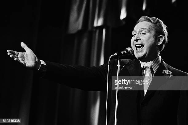 French singer and songwriter Charles Trenet on stage at the Bobino music hall in Paris