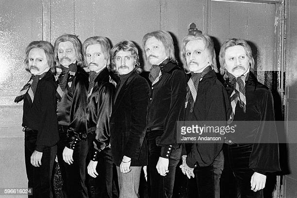 French singer and songwriter Christophe surrounded by lookalike's during his show at the Olympia music hall directed by composer JeanMichel Jarre