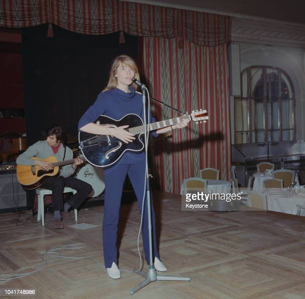 French singer and songwriter Francoise Hardy performs at the Savoy Hotel in London, UK, 1967.