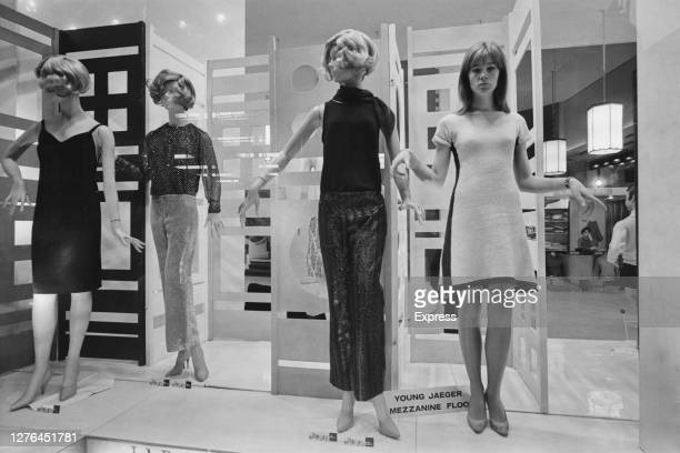 French singer and songwriter Françoise Hardy poses with the mannequins in a store on Regent Street, London, October 1965.